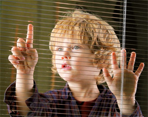 child at blinds