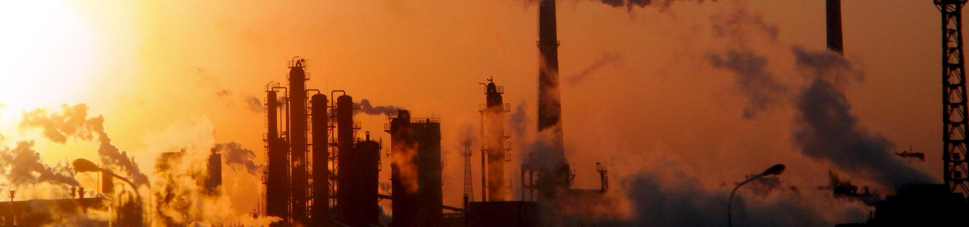global warming chimneys at sunset
